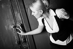 Young woman touching old door royalty free stock photos
