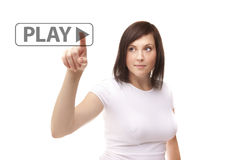 Young woman touching play Stock Photography