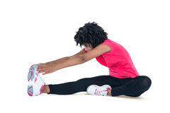 Young woman touching toes while exercising Royalty Free Stock Photography
