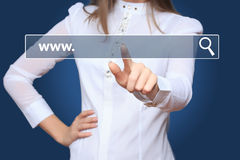 Young woman touching web browser address bar with www sign. Woman touching web browser address bar with www sign Stock Photography