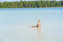 Young woman tourism sit rest on shallow after go to swimming at KohKham Island stock images