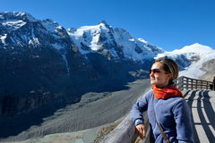 Young woman tourist in alpine zone Royalty Free Stock Photography