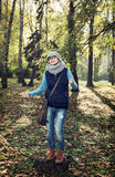 Young woman tourist in the autumn nature Royalty Free Stock Photo