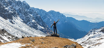 Young woman tourist backpacker standing mountain edge panorama. Stock Image