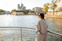 Woman enjoying landscape view on Paris city from the boat stock photography