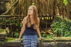 Young woman tourist explores the Monkey Forest in Ubud, Bali, Indonesia stock photos