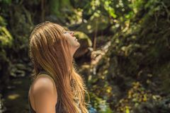 Young woman tourist explores the Monkey Forest in Ubud, Bali, Indonesia royalty free stock photo