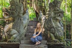 Young woman tourist explores the Monkey Forest in Ubud, Bali, Indonesia royalty free stock photos