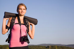 Young woman tourist in a hike. On a weekend Royalty Free Stock Photo