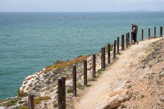 Young woman tourist hiking along the coast, Algarve region, Portugal Royalty Free Stock Photos