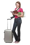 Young woman tourist holding book and map Stock Photo