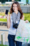 Young woman tourist holding map and phone Royalty Free Stock Photos