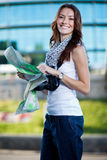 Young woman tourist holding paper map outdoors Stock Image