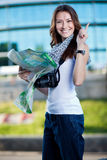 Young woman tourist holding paper map outdoors Royalty Free Stock Images