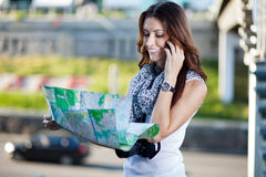 Young woman tourist holding paper map Stock Photo