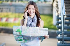 Young woman tourist holding paper map Stock Photography