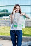 Young woman tourist holding paper map Stock Image