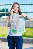 Young woman tourist holding paper map Royalty Free Stock Images