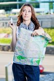 Young woman tourist holding paper map Stock Photos