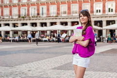 Young woman tourist holding a paper map Stock Photos