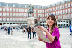 Young woman tourist holding a paper map Royalty Free Stock Photography