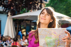 Young woman tourist holding a paper map Stock Images