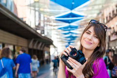 Young woman tourist holding a photo camera Royalty Free Stock Image
