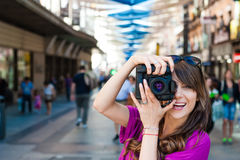 Young woman tourist holding a photo camera Royalty Free Stock Photo