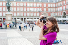 Young woman tourist holding a photo camera Royalty Free Stock Images