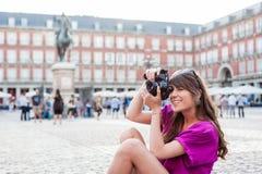 Young woman tourist holding a photo camera Stock Photo