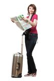 Young woman tourist looking at map Stock Photography