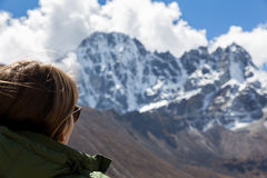 Young woman tourist looking at  mountains ridge view. Stock Photography