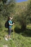 Young woman tourist in the mountainous terrain Stock Photos