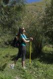 Young woman tourist in the mountainous terrain Stock Image