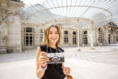 Woman near the old beautiful building in Vichy city, France Stock Photo
