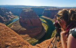 Young woman tourist photographer in grand canyon Royalty Free Stock Images