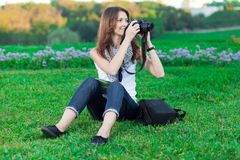 Young woman tourist photographing Royalty Free Stock Photos