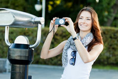 Young woman tourist photographing Royalty Free Stock Image