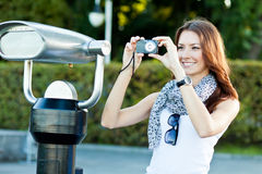 Young woman tourist photographing Stock Images