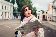 Young woman tourist searching for right way using map in Odessa. Girl lost in city. Traveler going sightseeing. Young woman tourist searching for right way using royalty free stock photos
