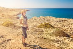Young woman tourist, Cyprus Ayia Napa, Cape Greco peninsula, national forest park royalty free stock images