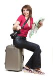 Young woman tourist sitiing on the suitcase Stock Photography