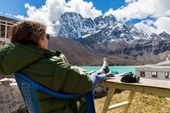 Young woman tourist sitting resting infront mountains ridge view Royalty Free Stock Images