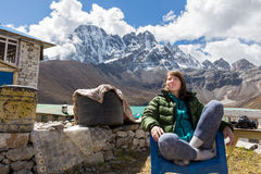 Young woman tourist sitting resting mountains ridge view. Royalty Free Stock Image