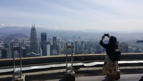 Young woman tourist takes picture in malaysia stock photo