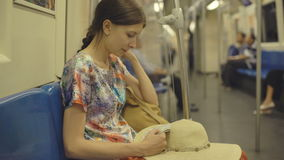Young woman tourist travelling in subway and looking in map in Bangkok subway during vacation. Young woman tourist travelling in subway and looking in map in stock video