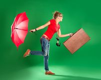 Young woman tourist with umbrella and a suitcase Royalty Free Stock Image