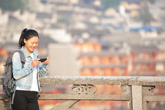 Young woman tourist use smart phone  Stock Photography