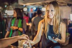 Young woman tourist on Walking street Asian food market royalty free stock photos