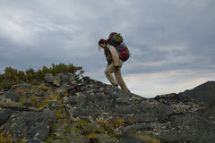 Young woman tourist walking on top of the mountain ridge Barguzi Royalty Free Stock Images